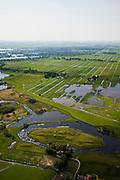 Nederland, Noord-Holland, Gemeente Ouder-Amstel, 25-05-2010. Natuurreservaat Botshol en Fort Bosthol (onderdeel van de Stelling van Amsterdam.  Moeras- en plassengebied,  onstaan door vervening..Natura 2000-gebied, stiltegebied. .Nature area Botshol, swamp and lake area result of digging of peat..Natura 2000 site, sanctuary..luchtfoto (toeslag), aerial photo (additional fee required).foto/photo Siebe Swart