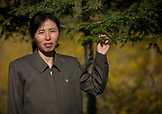Fashion in North Korea<br /> <br /> In every corner of the earth, women love to look beautiful and keep up with the latest fashion trends. The women of North Korea are no different. Fashion is taken seriously here. But in North Korea, women do not read Elle or Vogue; they just glimpse a few styles by watching TV or by observing the few foreigners who come to visit. In the hermit kingdom, clothing also reflects social status. If you have foreign clothes it means you travel and are consequently close to the centralized power. Chinese products have inundated the country, adding some color to the traditional outfits that were made of vynalon fiber. But citizens beware, too much style means you're forgetting the North Korean juche, the ethos of self-reliance that the country is founded on! But the youth tend to neglect it despite the potential consequences.<br /> <br /> Photo shows: Most of the people wear clothes made of the vynalon, a synthetic fiber created in the 50s which is the pride of North Korea. The Dear Leaders wear this very same material. It has become the national fibre of North Korea and is used for the majority of textiles. It is very stiff, uncomfortable, and makes people look like robots. A big problem with vynalon is that there aren't many colors to choose from. This added to the dull look of DPRK in the past.<br /> ©Eric Lafforgue/Exclusivepix Media