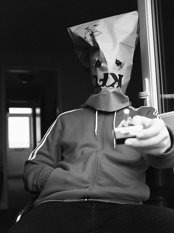 Thomas Cunningham is pictured wearing a KFC bag on his head inside Arle Gardens in Cheltenham, Gloucestershire during England's second lockdown folllowing a rise in COVID-19 cases.