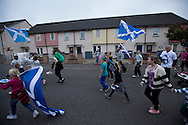 Children running ahead of a spontaneous march to mobilise support for a pro-independence vote in the Craigmillar district of Edinburgh on the day of the independence referendum. Yes Scotland were campaigning for the country to leave the United Kingdom, whilst Better Together were campaigning for Scotland to remain in the UK. On the 18th of September 2014, the people of Scotland voted in a referendum to decide whether the country's union with England should continue or Scotland should become an independent nation once again and leave the United Kingdom.