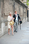 AMANDA DYER; MARK DYER LEAVING THE RECEPTION WITH GOODY BAG, The Royal Wedding of Prince William and  Catherine Middleton. Scenes around Buckingham Palace and the Mall.   London. 29 April 2011. , -DO NOT ARCHIVE-© Copyright Photograph by Dafydd Jones. 248 Clapham Rd. London SW9 0PZ. Tel 0207 820 0771. www.dafjones.com.