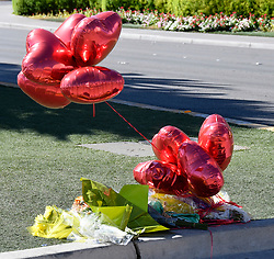 Oct 3,2017. Las Vegas NV.  Some balloons and flowers left at the sight after Sundays mass shooting Tuesday morning.  The latest on victims as of Tuesday is still 59 dead, 527 injured last reported Monday night.  The shooting happen during day 3 of the Route 91 Harvest Festival.. Photo by Gene Blevins/ZumaPress. (Credit Image: © Gene Blevins via ZUMA Wire)