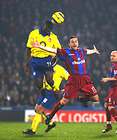 Fotball<br /> Premier League 2004/2005<br /> 06.11.2004<br /> Foto: SBI/Digitalsport<br /> NORWAY ONLY<br /> <br /> Crystal Palace v Arsenal<br /> <br /> Michael Hughes of Crystal Palace goes up for an aerial ball with Kolo Toure of Arsenal