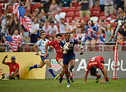 USA's Perry Baker runs in a try during the HSBC World Rugby Sevens Series, Singapore, Cup Final match USA -V- Canada  at The National Stadium, Singapore on Sunday, April 16, 2017. (Steve Flynn/Image of Sport)