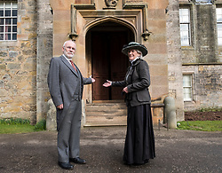 Edinburgh, Scotland, United Kingdom . 27th February, 2018. Volunteers wearing Edwardian costumes prepare to give Lauriston Castle in Edinburgh a Spring clean in preparation for the public opening later in the year. Pictured, Chris Pearson and Linda MacDonald.