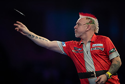 Peter Wright during his match against Toni Alcinas during day four of the William Hill World Darts Championships at Alexandra Palace, London.
