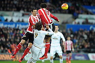 Swansea's Alberto Paloschi (9) is challenged by Southampton's Jose Fonte (l) and Virgil Van Dijk. Barclays Premier league match, Swansea city v Southampton at the Liberty Stadium in Swansea, South Wales on Saturday 13th February 2016.<br /> pic by  Carl Robertson, Andrew Orchard sports photography.