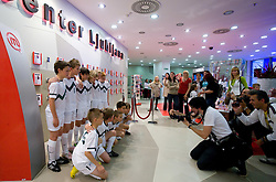 Young football players and photographer Ciril Jazbec at visit  of Slovenian National Football team in Mobitel center, on May 19, 2010 in Ciytpark, BTC, Ljubljana, Slovenia. (Photo by Vid Ponikvar / Sportida)
