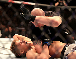 Oliver Enkamp reacts after being knocked out by Danny Roberts at The O2 Arena, London.