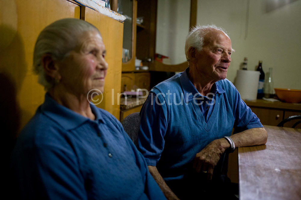 """Felicia and Baldassare and De Simons, in their kitchen in the village of Somma Vesuviana, in the Red (evacuation) Zone on the western slope of Vesuvius which last erupted in 1944. Their family have owned this land for generations, the family would choose to stay if the volcano erupts again. """"I was born here, I grew up here, I will die here, I've never been afraid here,"""" says Baldassare. But Giuseppe Mastrolorenzo at the Vesuvius Volcano Observatory in Naples adds, """"There would be no modern precedent for an evacuation of this magnitude .. This is why Vesuvius is the most dangerous volcano in the world."""" From the chapter entitled 'Under the Volcano' and from the book 'Risk Wise: Nine Everyday Adventures' by Polly Morland (Allianz, The School of Life, Profile Books, 2015)."""