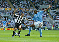 Photo: Andrew Unwin.<br />Newcastle United v Manchester City. The Barclays Premiership. 24/09/2005.<br />Newcastle's Michael Owen (L) looks to avoid Manchester City's Sylvain Distin (R).
