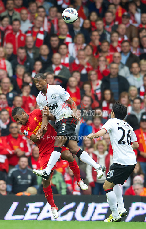 LIVERPOOL, ENGLAND - Sunday, September 23, 2012: Liverpool's Raheem Sterling in action against Manchester United's Patrice Evra during the Premiership match at Anfield. (Pic by David Rawcliffe/Propaganda)
