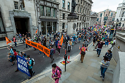 """© Licensed to London News Pictures. 03/09/2021. LONDON, UK.  Climate activists from Extinction Rebellion protest march from St Paul's Cathedral, via the Bank of England, to the Lloyds Building in the City of London to highlight the complicity of the financial industry on climate change.  The event takes place on day twelve of the two week 'Impossible Rebellion' protest to """"target the root cause of the climate and ecological crisis"""".  Photo credit: Stephen Chung/LNP"""