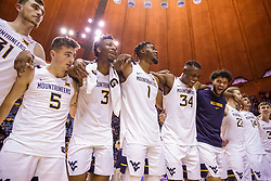 Dec 14, 2019; Morgantown, WV, USA; West Virginia Mountaineers forward Logan Routt (31) and West Virginia Mountaineers guard Jordan McCabe (5) and West Virginia Mountaineers forward Gabe Osabuohien (3) and West Virginia Mountaineers forward Derek Culver (1) and West Virginia Mountaineers forward Oscar Tshiebwe (34) and West Virginia Mountaineers guard Jermaine Haley (10) celebrate after defeating the Nicholls State Colonels at WVU Coliseum. Mandatory Credit: Ben Queen-USA TODAY Sports
