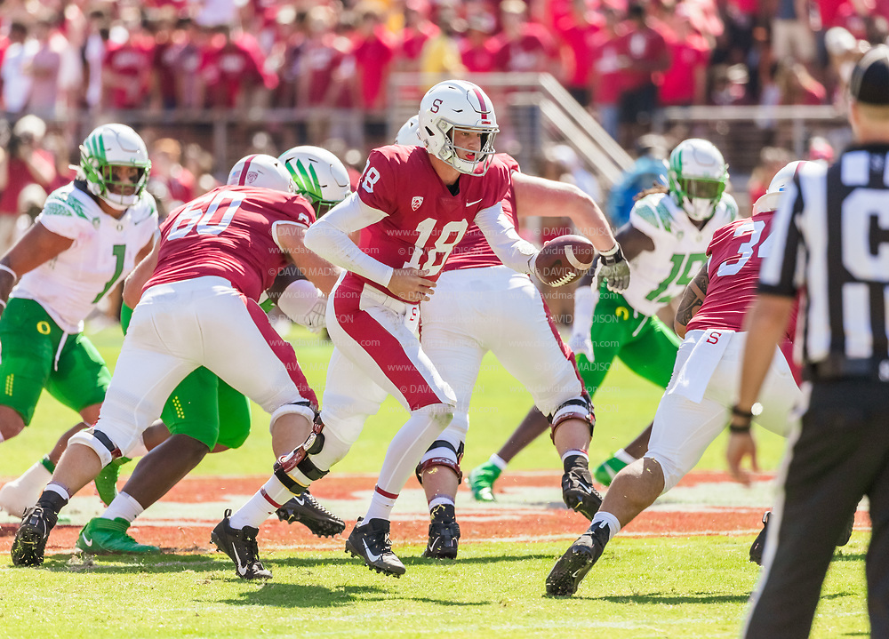 PALO ALTO, CA - OCTOBER 2:  Tanner McKee #18 of the Stanford Cardinal hands off during an NCAA Pac-12 college football game against the Oregon Ducks on October 2, 2021 at Stanford Stadium in Palo Alto, California.  (Photo by David Madison/Getty Images)