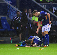 Leicester City's Daniel Drinkwater checks on team-mate Liam Moore as he lays on the ground injured<br /> <br /> Photo by Chris Vaughan/CameraSport<br /> <br /> Football - The Football League Sky Bet Championship - Leicester City v Middlesbrough - Saturday 25th January 2014 - The King Power Stadium - Leicester<br /> <br /> © CameraSport - 43 Linden Ave. Countesthorpe. Leicester. England. LE8 5PG - Tel: +44 (0) 116 277 4147 - admin@camerasport.com - www.camerasport.com