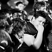 John Bledsoe (11) comforts his teammate Noah Cooper (76) after Summit lost to Dallas 28-29 in the quarterfinals of Class 5A state playoffs in Bend on Friday.