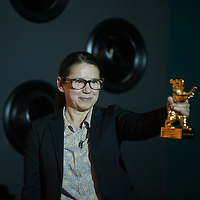 """Movie director Ildiko Enyedi of Hungary holds her new Golden Bear won by movie """"On Body and Soul"""" during a press conference in Budapest, Hungary on February 21, 2017. ATTILA VOLGYI"""