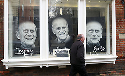 File photo dated 13/04/21 of pictures of the Duke of Edinburgh displayed in a gallery window in Windsor. Plans for the Duke of Edinburgh's funeral have been modified in light of Covid-19 restrictions, but the ceremonial aspects of the day and the service are still in line with Philip's wishes, Buckingham Palace has said. Issue date: Friday April 16, 2021.
