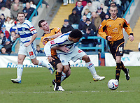 Photo: Kevin Poolman.<br />Queens Park Rangers v Wolverhampton Wanderers. Coca Cola Championship. 04/03/2006. <br />Wolves' Mark Davies (L) and Richard Langley fight over the ball.