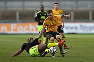 Uche Ikpeazu of Cambridge Utd (l) tackles Mark O'Brien of Newport county. The Emirates FA Cup, 2nd round match, Newport County v Cambridge United at Rodney Parade in Newport, South Wales on Sunday 3rd December 2017.<br /> pic by Andrew Orchard,  Andrew Orchard sports photography.