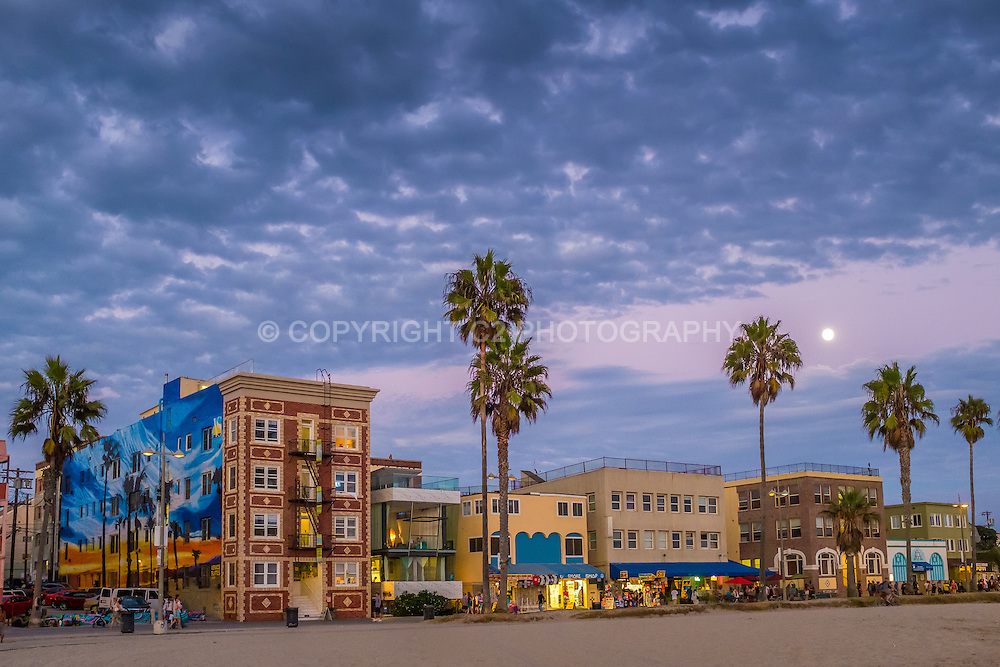 Venice Beach and the boardwalk at dusk in Los Angeles, California.