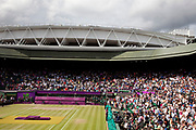 Crowds watch in Centre Court as the Tennis events at the London 2012 Olympics take place at Wimbledon.
