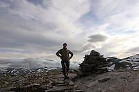 Mann ved varden på Langfjellet i Trollheimen, man by the carin at Langfjellet in Trollheimen