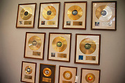 London, UK. Friday 23rd November 2012. Christies auction house showcasing memorabilia from every decade of the past century of popular culture from the industries of film and music. Gold discs from The Beatles.
