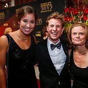 NLD/Amsterdam/20121218 - NOC/NSF Sportgala 2012, Jochem Ranomi Kromowidjojo, Uytdehaage en partner Danielle Mouissie