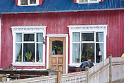 Traditional typical painted corrugated metal house in the old town area of capital city Reykjavik, Iceland