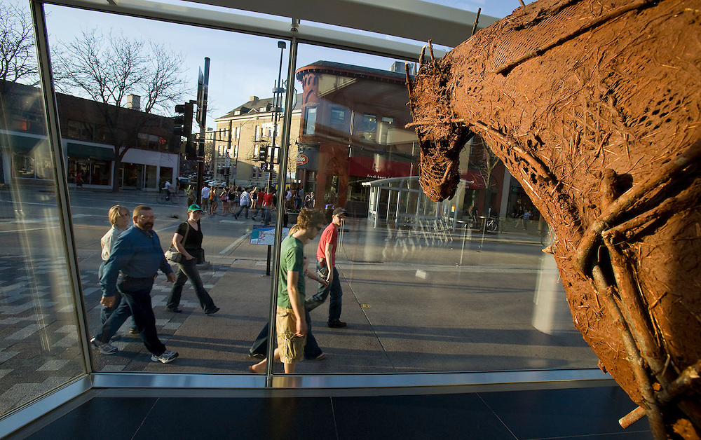 Pedestrians on State Street in Madison, Wis., pass a sculpture by Deborah Butterfield at the Madison Museum of Contemporary Art.  (Photo @ Andy Manis)