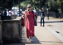 © Licensed to London News Pictures. 10/08/2021. Members of the public relax In warm conditions in Hyde Park, central London on a warm summer's day. A period of warmer conditions is expected across the UK following several days of torrential rain. Photo credit: Ben Cawthra/LNP