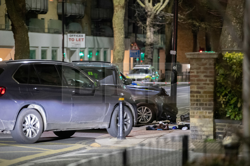 © Licensed to London News Pictures. 07/04/2021. London, UK. A vehicle that has crashed into a pole and items of clothing on Chiswick High Road following a incident in which a vehicle was stopped at approximately 22:30hrs on Wednesday 07/04/2021 when police approached the vehicle, officers discovered the lone male occupant had sustained a number of serious self-inflicted injuries. First aid was commenced immediately and the London Ambulance Service were called. The male has been taken to a west London hospital. Photo credit: Peter Manning/LNP