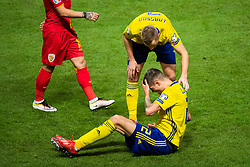 March 23, 2019 - Stockholm, SWEDEN - 190323 Sebastian Larsson tends to Mikael Lustig of Sweden after a duel during the UEFA Euro Qualifier football match between Sweden and Romania on March 23, 2019 in Stockholm  (Credit Image: © Simon HastegÃ…Rd/Bildbyran via ZUMA Press)