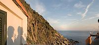 Shadows of couple enjoying wine at sunset, Mediterranean Sea, Vernazza, Italy.