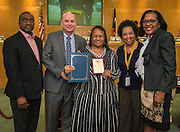 Jeanneter Dagins, center, is recognized as Employee of the Month during a meeting of the Houston ISD Board of Trustees, March 10, 2016.