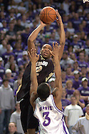 Colorado forward Martane Freeman (C) scores over  Kansas State's Lance Harris (3) during the first half of the Wildcats 72-60 win over the Buffaloes at Bramalage Coliseum in Manhattan, Kansas, February 18, 2006.