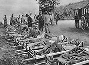 World War I 1914-1918: Wounded Austrian soldiers waiting on stretchers outside a field hospital; One of the Battles of Isonzo,  Italian Front, 1915.  Military, Army, Medicine, Casualty