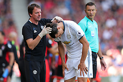 Zlatan Ibrahimovic of Manchester United receives treatment to the back of his head - Rogan Thomson/JMP - 14/08/2016 - FOOTBALL - Vitality Stadium - Bournemouth, England - Bournemouth v Manchester United - Premier League Opening Weekend.