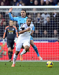 Swansea City's Ashley Williams battles for the ball with Tottenham Hotspur's Kyle Walker - Photo mandatory by-line: Joe Meredith/JMP - Tel: Mobile: 07966 386802 19/01/2014 - SPORT - FOOTBALL - Liberty Stadium - Swansea - Swansea City v Tottenham Hotspur - Barclays Premier League