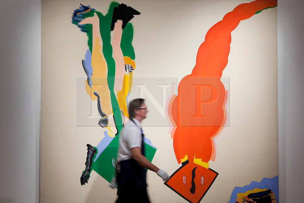 """© Licensed to London News Pictures. 03/09/2013. London, UK. A Sotheby's employee walks past """"Male and Female Composition"""" (1964-65) by Allen Jones during the press view for an exhibition of art from the 1960's at Sotheby's in London today (03/09/2013). The exhibition, entitled """"The New Situation: Art in London in the Sixties"""" and located at the auction house's New Bond Street building, is open to the public from 4th to the 11th of September 2013. Photo credit: Matt Cetti-Roberts/LNP"""