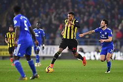 Watford's Etienne Capoue (centre) and Cardiff City's Harry Arter (right) battle for the ball during the Premier League match at the Cardiff City Stadium.