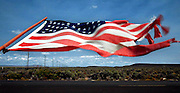 "Wind whips a flag along a fenceline south of Burns, Oregon in Harney County, one of the largest and least populated counties in America some have called ""The Big Empty.""<br />