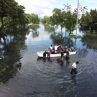 A boat navigates along the main highway between San Pedro Sula and the port of Puerto Cortés after it was flooded with hurricanes Eta and Iota hit Honduras.