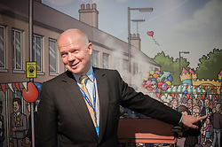 © Licensed to London News Pictures. 29/09/2014. Birmingham, UK. William Hague points at a characture of himself on a trade stand. The Conservative Party Conference in Birmingham 29th September 2014. Photo credit : Stephen Simpson/LNP