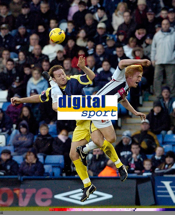 Photo: Leigh Quinnell.<br /> West Bromwich Albion v Derby County. Coca Cola Championship. 02/12/2006. Derbys Steve Howard collects a boot in the head from West Broms Paul McShane.
