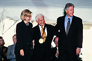 Latin percussionist Tito Puente is presented the National Medal of Arts by President Bill Clinton and First Lady Hillary Clinton during a ceremony on the South Lawn of the White House September 29, 1997 in Washington, DC.