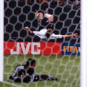 Germany's Miroslav Klose celebrates his second goal as  Saudi Arabia's Mohammed Al Deaya is beaten