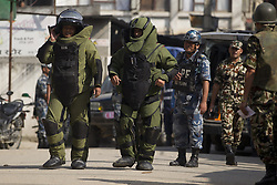 KATHMANDU, Sept. 20, 2016 (Xinhua) -- Members of a bomb disposal team get ready to inspect a suspicious pressure cooker after a bomb scare outside the Kanchanjunga School in Kathmandu, Nepal, Sept. 20, 2016. The scare was found true and later it was disposed.In four different schools of Kathmandu unknown group kept the different kinds of bombs. (Xinhua/Pratap Thapa).****Authorized by ytfs* (Credit Image: © Pratap Thapa/Xinhua via ZUMA Wire)